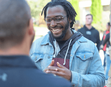 Black male student happy with others